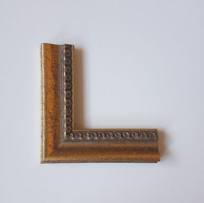 Gold coloured frame with Filigree detailing